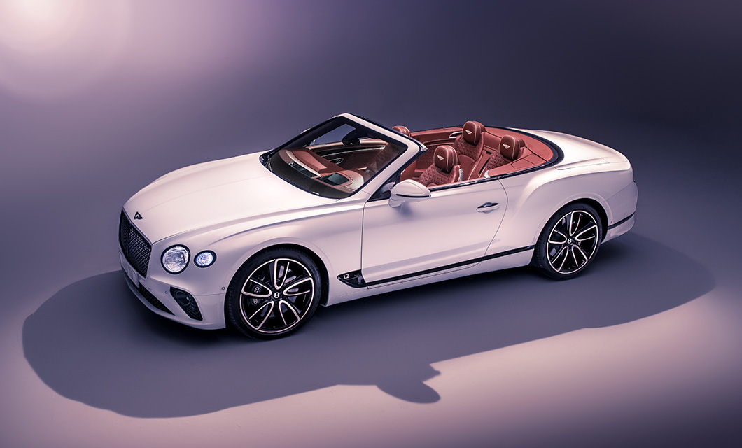 Studio shot of the Bentley Continental GT Convertible finished in Ice exterior paint and Cricket Ball interior