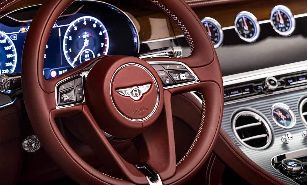 Interior of the Bentley Continental GT Convertible in Cricket Ball with Cotes de Geneve finish on the centre console
