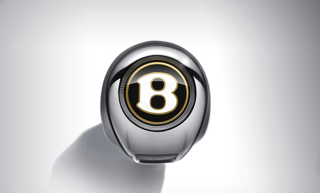 Gear lever of the Bentley Flying Spur with Bentley logo finished in Centenary Gold