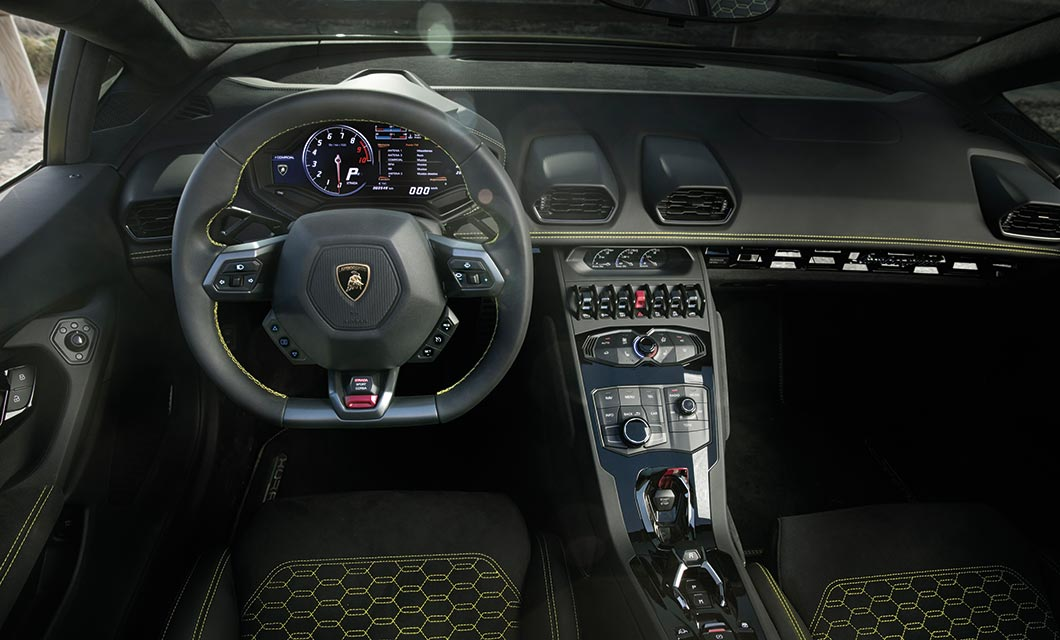 An interior shot of the Lamborghini Huracan Spyder finished in black with yellow stitch