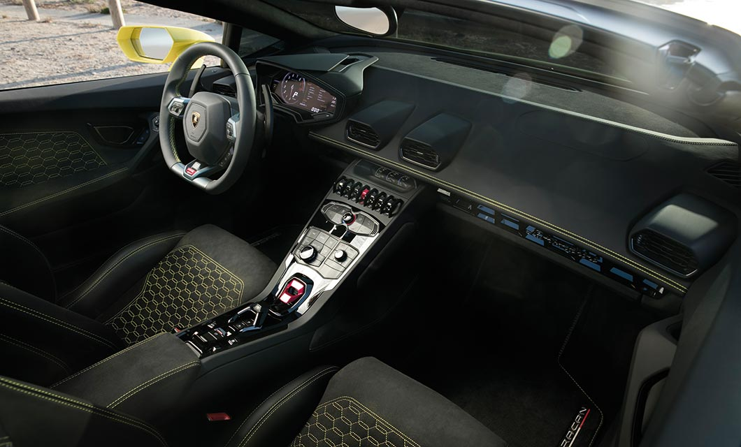 An interior shot of the Lamborghini Huracan Spyder finished in black alcantara with yellow stitch