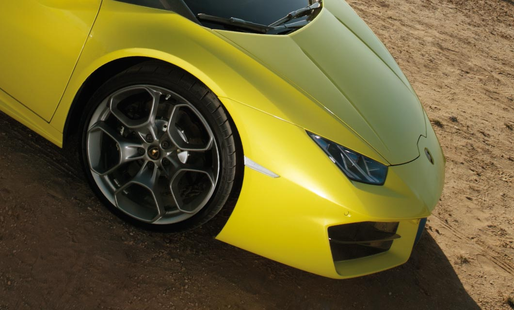 The front wheel of a Lamborghini Huracan finished in dark grey