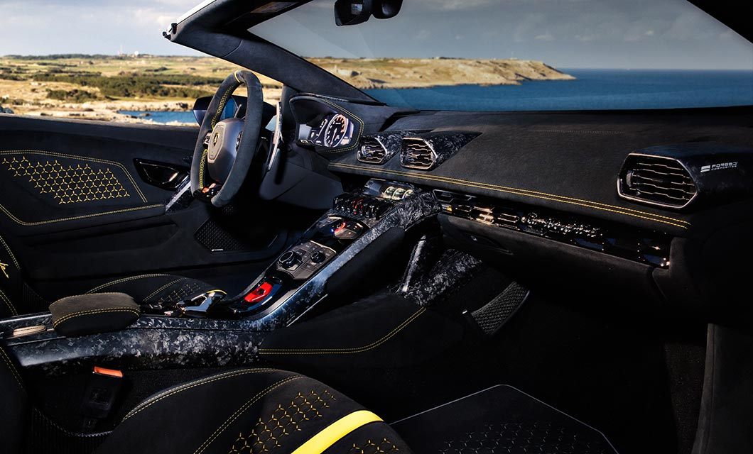 An interior shot of the Lamborghini Huracan Performante Spyder with black alcantara and yellow detailing