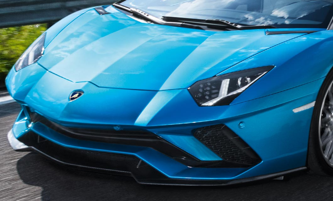 A front end shot of the Lamborghini Aventador S Roadster finished in a bright blue exterior paint