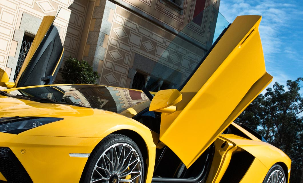 The Lamborghini Aventador S in bright yellow exterior paint with both doors open