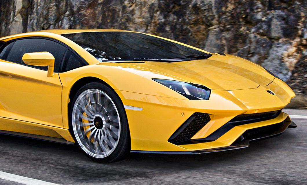 The front end of the Lamborghini Aventdor S finished in a bright yellow exterior paint and silver wheel