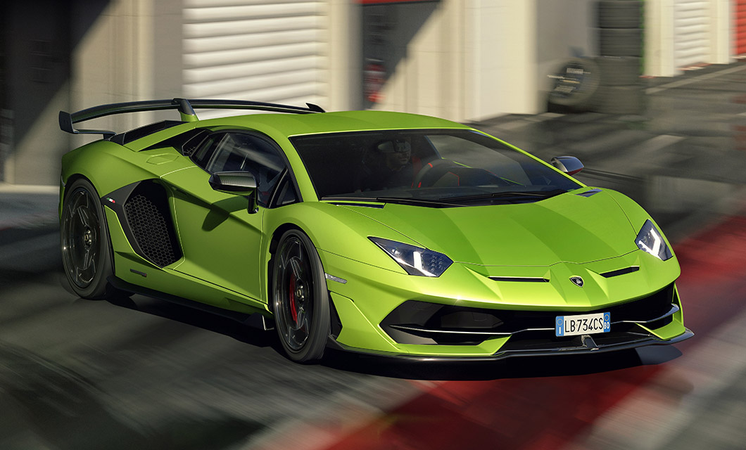 The Lamborghini Aventador SVJ finished in green exterior paint accelerates out of the pits on a racing circuit