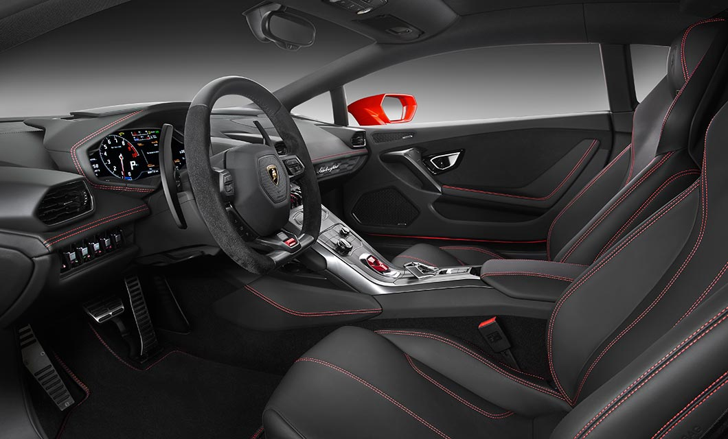 An interior shot of the Lamborghini Huracan finished in black leather with red stitch detail