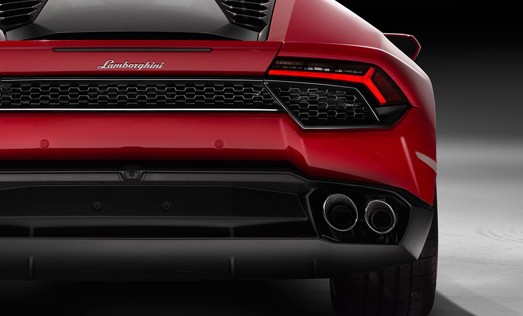 A close up rear shot of the Lamborghini Huracan finished in bright red exterior paint