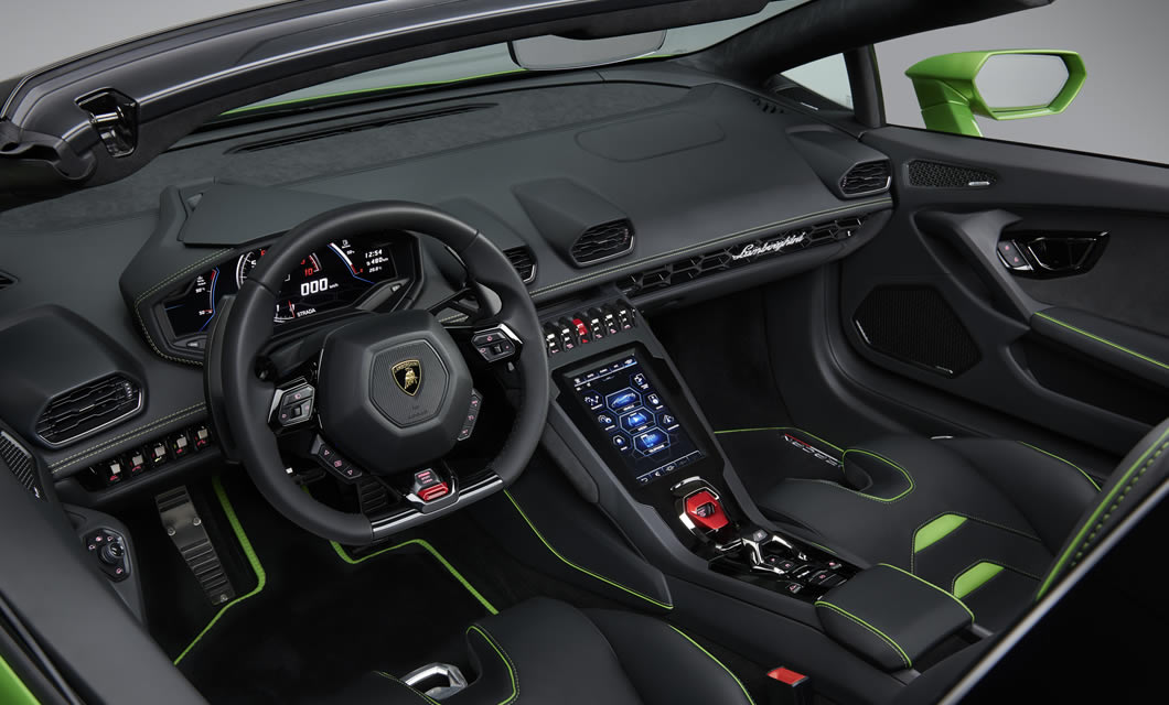 The interior of the all-new Lamborghini Huracan EVO Spyder finished in black in green, with the new touchscreen on display