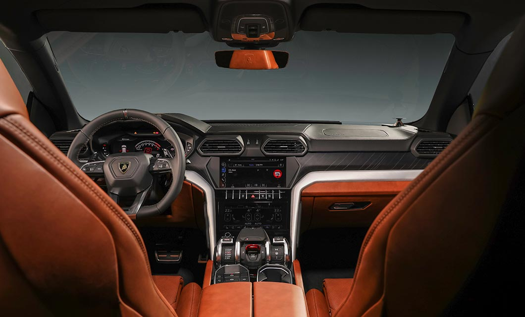 An interior shot of the Lamborghini Urus showing the touchscreen infotainment system